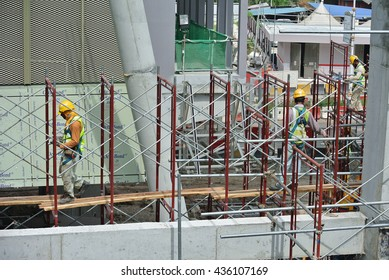 SERDANG, MALAYSIA -MAY 13, 2016: Construction workers working at the construction site at Serdang, Malaysia during daytime. They are wearing proper safety gear so ensure they are safe working.