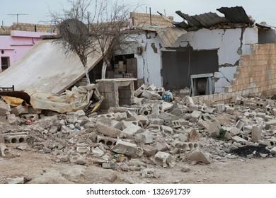 SEREKANIYE, SYRIA-MARCH 22: View of war damage from Serekaniye. Syrian war plane bombed Serekaniye. The Photo Taken, March 22, 2013