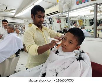 Seremban, Malaysia - 23/9/2018 : Young malay boy having his har cut at a mamak barbershop in Ampangan, Seremban. Mamak barbershop is among favourite shop for its cheap and professional services
