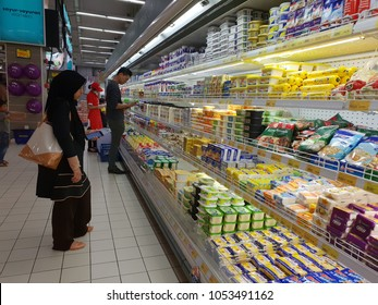 Seremban, Malaysia - 24/3/2018 : A female lady with hijab at the cold storage section in Mydin hypermarket Senawang. Mydin is the largest hypermarket chain in Malaysia