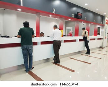 Seremban, Malaysia - 29/7/2018 : Customers getting served at the counter in Bank Islam Seremban branch, an Islamic financial institution in Malaysia