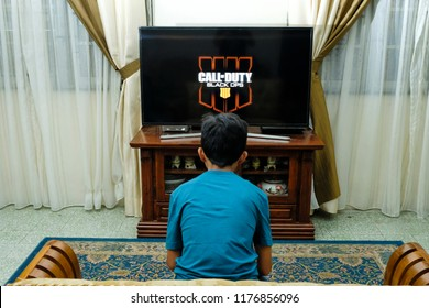Seremban, Malaysia - 9/9/2018 : A boy enjoy playing Call of Duty, Black Ops game on Sony PlayStation at home