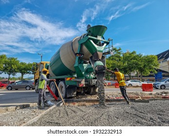 Seremban, Malaysia - 9th March 2021 : Labor workers put cements and concrete on the road in Ampangan