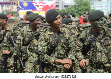 SEREMBAN, MALAYSIA -AUGUST 31, 2016: Malaysia Royal Malay Regiment in full uniform and armed during and after joining the Malaysia National Day parade 2016.