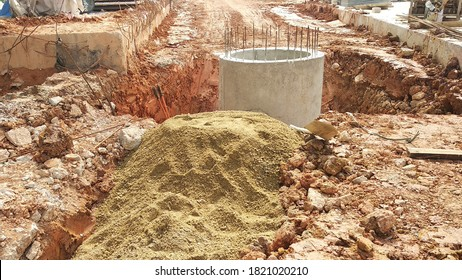SEREMBAN, MALAYSIA -AUGUST 6, 2020: Utility services manhole and underground pipes under construction at the construction site. In-situ construction by workers based on infrastructure engineer design.