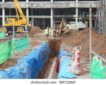 SEREMBAN, MALAYSIA -FEBRUARY 24, 2017: Underground utility and services pipe lay by workers at the construction site.
