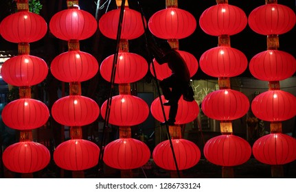 Seremban, Malaysia - January 17 2019, A workers prepare lanterns decoration at Zhi Yuan Tang Temple, Rasah.The Chinese Lunar New Year begins on 5 February and marks the start of the Year of Pig.