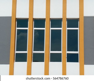 SEREMBAN, MALAYSIA -JANUARY 25, 2017: Architectural detail of series of casement window divided by orange color wall.