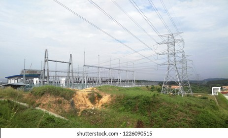SEREMBAN, MALAYSIA -JUNE 16, 2018: High tension galvanized iron pylon transmitting high voltage electrical power to the consumer.