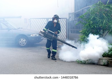 Seremban, Malaysian - July 01, 2019 : health personnel fogging chemical to anti mosquitoes. Mosquitoes are a carrier of Malaria, Encephalitis, Dengue and Zika virus
