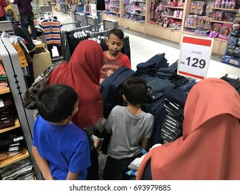 SEREMBAN,MALAYSIA.11 JUNE 2017. Mother and her children shopping attire during festival season at shopping mall