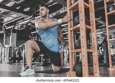 Serene athlete taking physical exercise