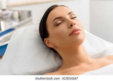 Serene attractive woman leaning in hospital bed