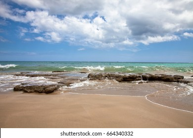 Serene beach in Puerto Rico with rolling waves