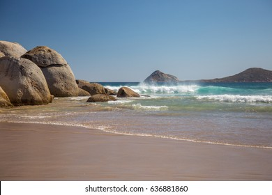Serene beach with rocks and ocean waves
