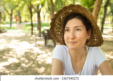 Serene brunette woman enjoying the sunny day in a recreation area