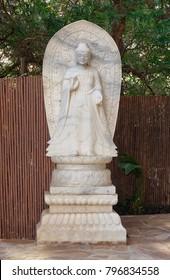 Serene Buddha marble statue in garden