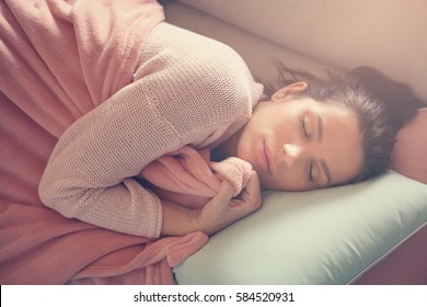 Serene Caucasian woman napping  on the couch.
