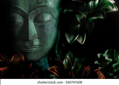 The serene face of Buddha in peaceful meditation. Many connotations of spiritual enlightenment. Peace, love and Zen.