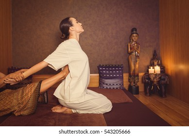 Serene girl enjoying thai massage