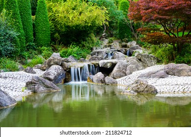 Serene image of a waterfall in Bonn, Germany in the Rheinhaue, A recreational park that covers approximately 40 acres