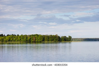 serene landscape, a lake, forest and cloudy sky