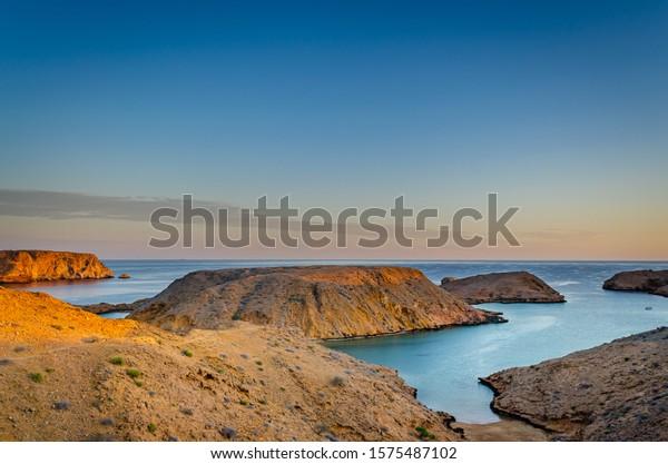 serene-landscape-mountains-sea-golden-60
