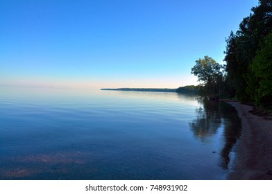 A serene morning sunrise on Grand Traverse Bay of Lake Michigan.