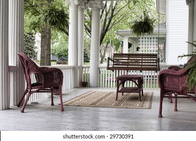 Serene old fashioned porch with wicker furniture in spring.
