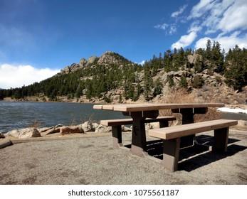 Serene picnic table near wilderness lake
