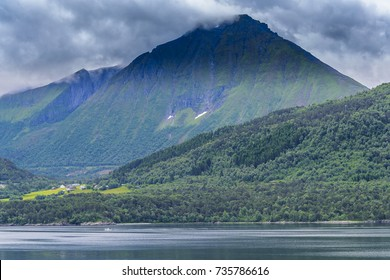 Serene Scandinavian landscape seascape with islands, blue skies and puffy clouds.