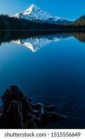 Serene scene with the reflection of Mount hood in calm waters of Lost Lake in Oregon, USA