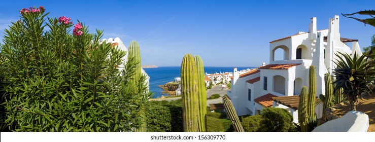 Serene scenic view over looking traditional villas and calm blue sea.