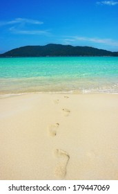 Serene view of footprints in the sandy beach