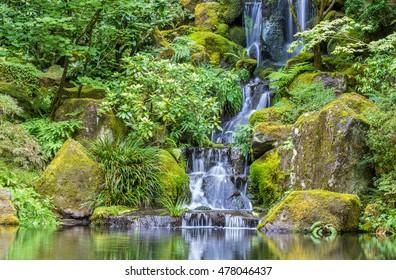 A serene waterfall in Portland's Japanese Garden.