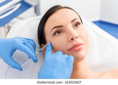 Serene woman receiving cosmetic procedure