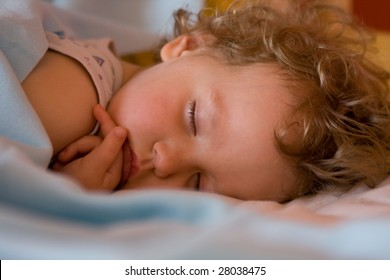 Serenely sleeping a little girl
