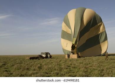 Serengeti National Park, Tanzania - March 11, 2017 :  Staff and crew of hot air balloon company on Serengeti, Tanzania, Africa.