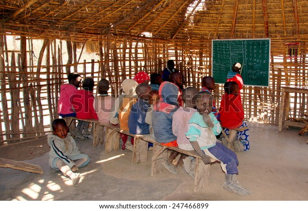 SERENGETI ,TANZANIA - JUNE 20 ; Maasai children at there classroom on june 20,2013 .Tanzania.Only 48 percent of Maasai children  go to school, only 10 percent of them make it to secondary school.