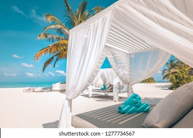 Serenity beach background, luxury beach canopy and travel or summer vacation concept. Luxury beach scene. Summer vacation and holiday concept