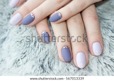Serenity manicure with diamonds. Shaggy background