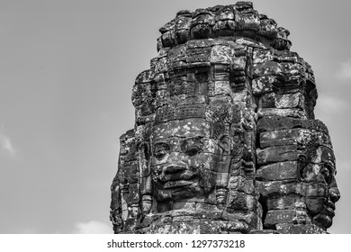 The serenity of the stone faces, Bayon Temple, Angkor Thom ,Cambodia. The Bayon's most distinctive feature is the multitude of serene and smiling stone faces on the many towers. Black and White image