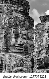 The serenity of the stone faces, Bayon Temple, Angkor Thom ,Cambodia. The Bayon's most distinctive feature is the multitude of serene and smiling stone faces on the many towers Black and White image