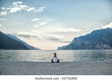serenity and yoga practicing at the lake Garda