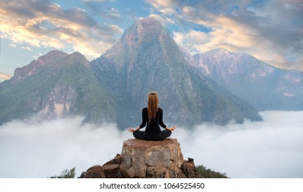 Serenity and yoga practicing at mountain range,meditation  - Shutterstock ID 1064525450