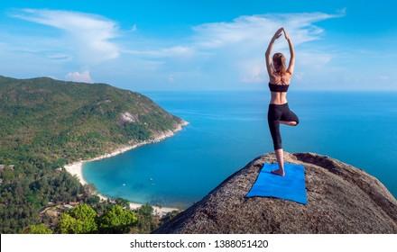 Serenity and yoga practicing at mountain range,meditation,vrikshasana