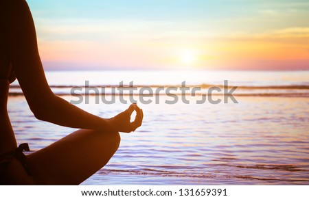 serenity and yoga practicing at sunset, meditation