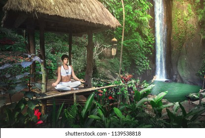 Serenity and yoga practicing at waterfall,Bali,Imdonesia