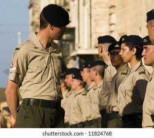 Sergeant major inspecting his subordinates in Malta