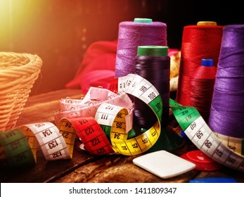 Serger or overlock thread in seamstress with group sew object sewing spool on morning sunrise light sun flare. Exhibition of accessories. Every season the range is always updated.